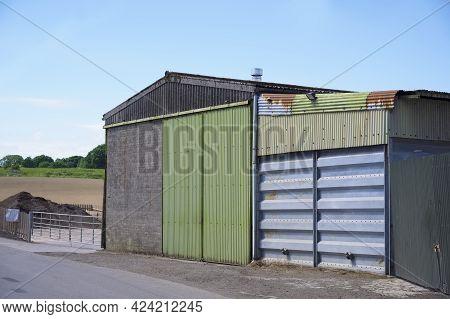 Farm And Farmyard Buildings In Rural Countryside