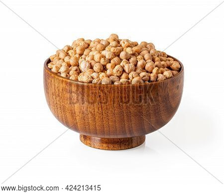 Chickpea Raw Dry Beans In A Wooden Bowl Isolated On White Background. Ingredient Of Vegetarian Food