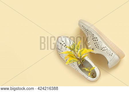Fashionable Beautiful Summer Shoes With Bouquet Of Spring Foliage. White Leather Loafers With Laces.