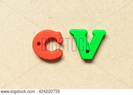 Plastic Alphabet Letter In Word Cv (abbreviation Of Curriculum Vitae) On Wood Background