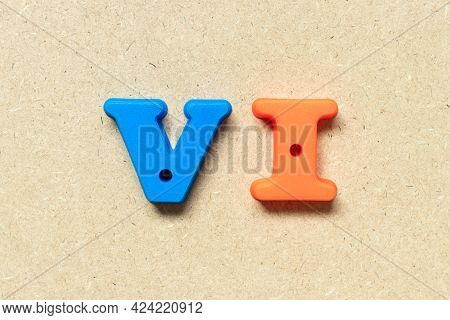 Plastic Alphabet Letter In Word Vi (abbreviation For Value Investor) On Wood Background