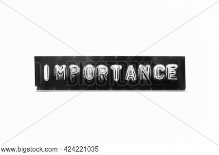 Embossed Letter With Word Importance In Black Banner On White Paper Background