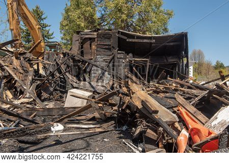 House In Ruins From A Fire, Demolished, On A Blue, Cloudless Sky