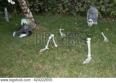 Suburbia Backyard Loan Halloween Decorations Featuring An Allien With Carnival Mask, Colorful Orange