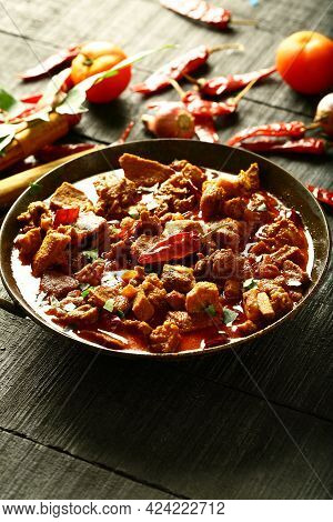 Indian Mutton Curry Roast. Traditional Cuisine Cooked With Exotic Spices In Iron Skillet.
