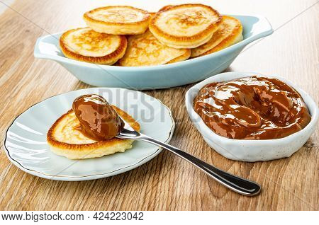 Pancakes In Oval Plate, Spoon With Condensed Milk On Pancake In Saucer, Sweet Boiled Condensed Milk