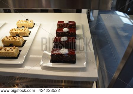 Chocolate Cakes Or Sugary Desserts In Display Case