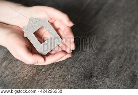 Hands Holding Paper House, Eco House, Family Home, House Insurance Concept, Green Sustainable Living