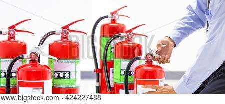Fire Extinguisher, Firefighter Checking Handle Of Fire Extinguisher Tank In The Building Concepts Of