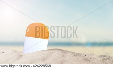 Sunscreen Bottle In Sand On Beach With Space For Your Text