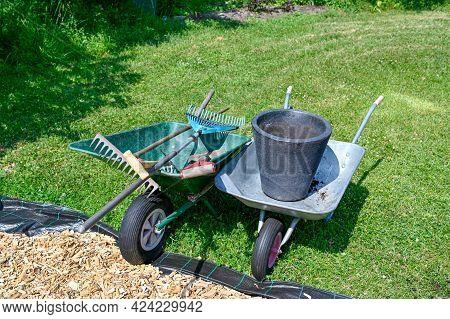 Wheelbarrows Ful Of Garden Tools On Lawn