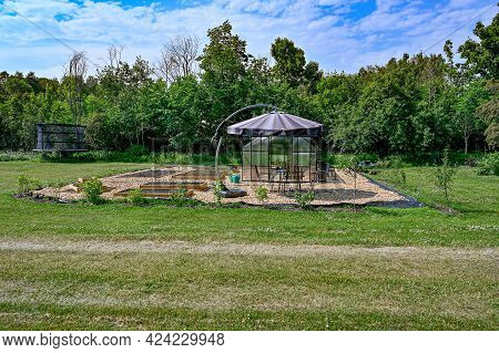 Greenhouse Table And Chairs With Sunshade In Garden