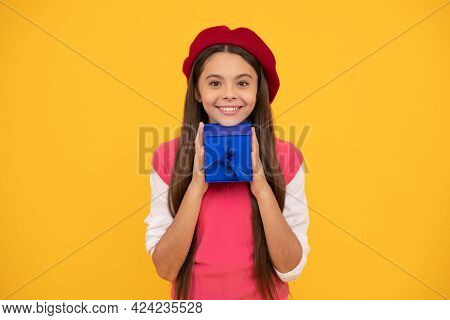 Happy Teen Girl In French Beret Hold Present Or Gift Box On Yellow Background, Present