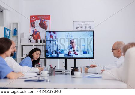 Teamwork Discussing Sickness Treatment During Online Videocall Telemedicine Teleconference Working I