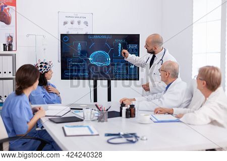 Physician Pointing Medical Radiography To Hospital Coworkers Analysing Brain Sickness Presentation U