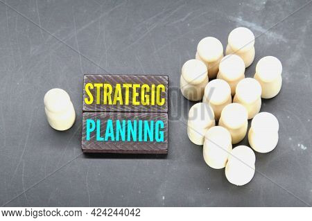 Peg Doll, Colored Cubes And The Word Strategic Planning