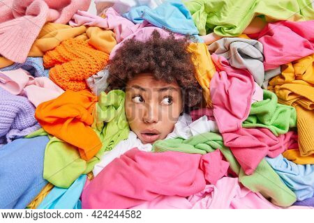 Woman Head Sticking Out Through Different Multicolored Clothes Looks Away With Stunned Expression Ar