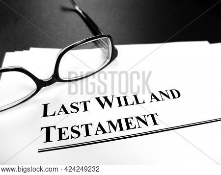 Probate last will and testament Estate Planning documents on the desk with glasses