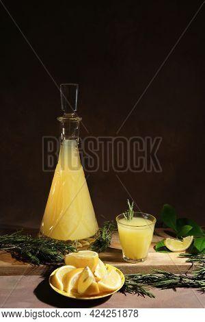 Limoncello Alcohol Drink. Italian Lemon Liqueur, Lemons And Limoncello Decanter.