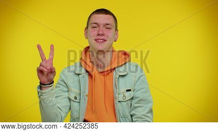 Handsome Stylish Teen Boy In Denim Jacket Showing Victory Sign, Hoping For Success And Win, Doing Pe