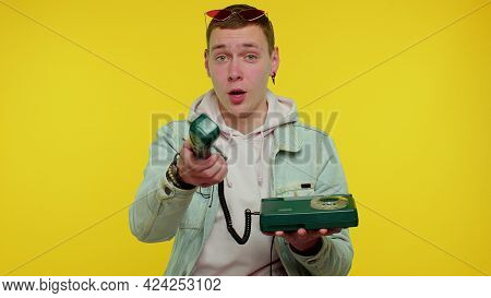 Hey You, Call Me Back. Cheerful Teen Boy Secretary In Denim Jacket Talking On Wired Vintage Telephon