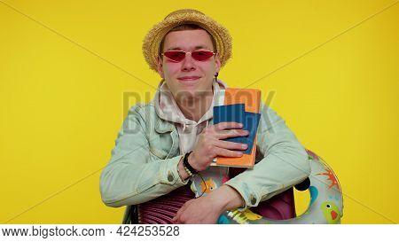 Traveler Tourist Cheerful Teen Stylish Boy Celebrating, Dancing Holding Passport, Tickets, Luggage.