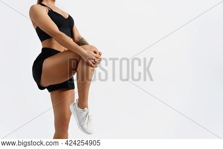 Cropped Image Of A Fitness Woman Stretching Her Legs Before Jogging Workout Outdoors. Fit Female Run