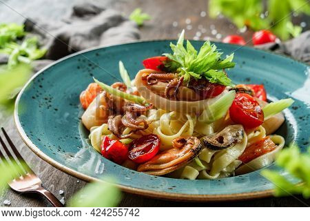 Pasta With Seafood, Langoustine, Oysters, Squid, Cuttlefish, Mussels, Shrimps, Celery Root And Lemon