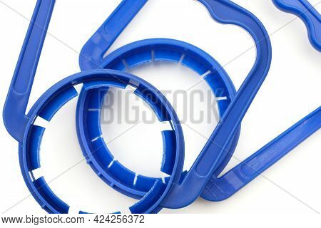Plastic Blue Handles For Bottles Of Large Sizes On A White Background. Handles For Pet Bottles For T