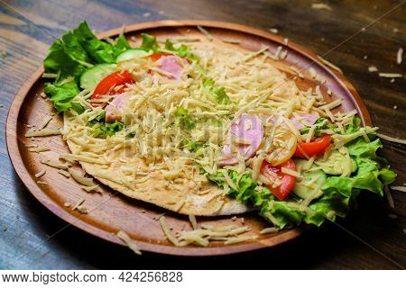 Pita With Vegetables, Sausage And Cheese.simple And Delicious Snack Of Flatbread