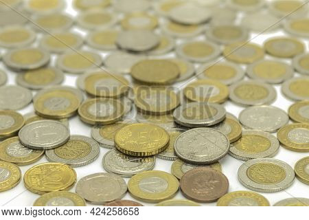 Coins Of Different Denominations And Different Countries. Coins Are Different Money. Money, Us Cents