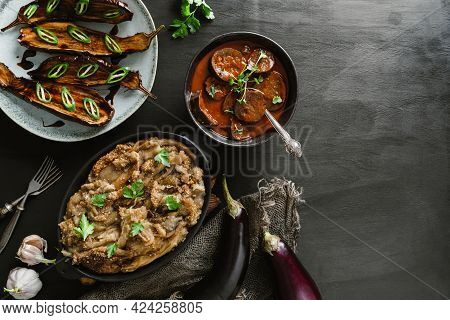 Various Baked Eggplant Dishes, Grilled Eggplant With Spicy Sauce, Mashed Eggplant With Parsley On Pa