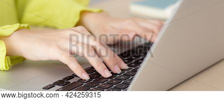 Closeup Of Hand Young Asian Businesswoman Working On Laptop Computer On Desk At Home Office, Freelan