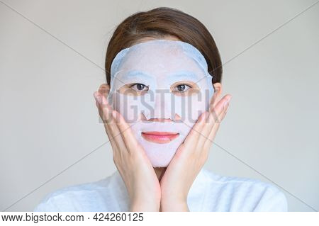 Portrait Of Young Woman Applying Facial Mask For Enhance Her Skin And Looking To Camera. Facial Mask