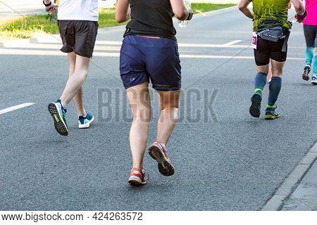 3 Rd Wizz Air Katowice Half Marathon, Katowice, Silesia, Poland.  June 19, 2021.  Legs Of Runners In