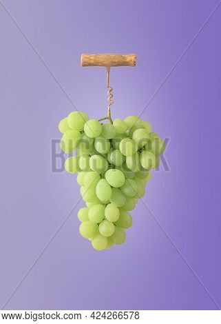 The Creative Concept Of Winemaking. A Bunch Of Grapes With A Wine Corkscrew On A Purple Background.
