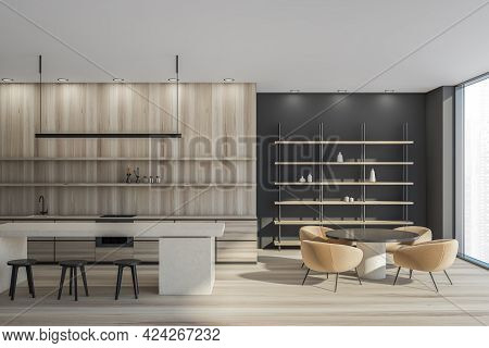 Minimalist Kitchen Interior With Round Table, Armchairs And Bar Chairs. Rack With Decoration Near Wi