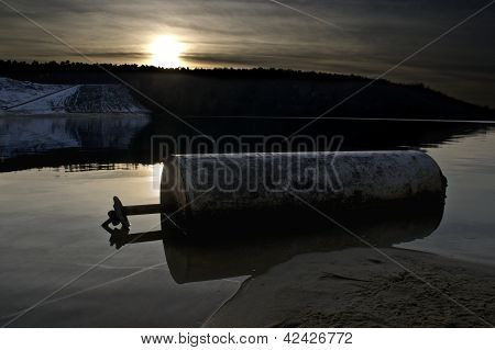 Buoy in front of Snowy Sand