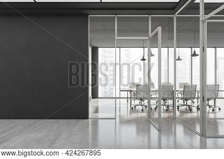 Office Interior With Grey Floor, Mockup Copy Space On Black Wall. Meeting Room With White Armchairs