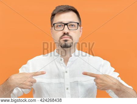 Bearded Handsome Man In Eyeglasses Pointing Oneself With Fingers. Shows Himself, A Confident Calm Gu
