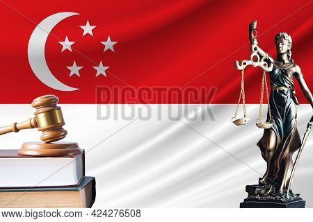 Law And Justice In Singapore. Statue Of Themis And The Gavel Of The Judge Against The Background Of
