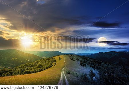 Day And Night Time Change Concept Above Road Through Meadow In Mountains. Beautiful Rural Landscape