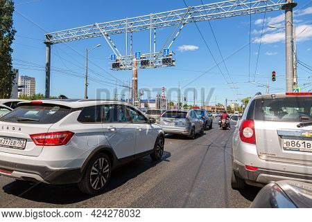 Samara, Russia - June 18, 2021: Cars Drive Along City Street With Multi-lane Traffic In Summer
