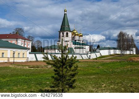 Behind The Stone Wall Is The Hipped Bell Tower Of The Valdai Iversky Svyatoozersky Bogoroditsky Mona