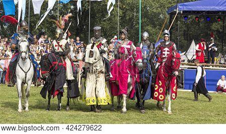 Knights In Armor On Horseback. Knights In Armor, Minsk, Belarus, September 8, 2018 City Holiday
