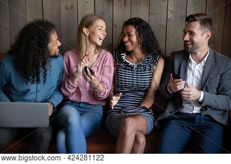 Happy Young Mixed Race Friendly People Using Different Gadgets.