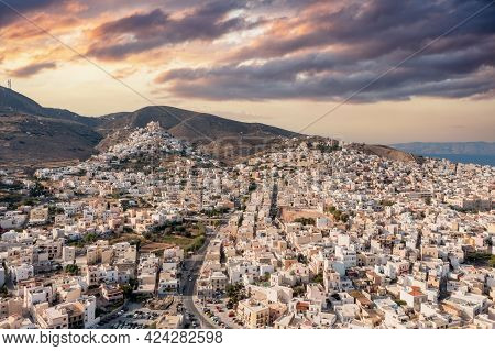 Syros Island, Greece, Aerial Drone View. Ermoupolis And Ano Siros Town Cityscape, Cloudy Sky At Suns