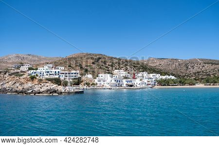 Sikinos Greek Island Port, White Buildings And Blue Sky Background. Summer Holidays At Cyclades, Gre