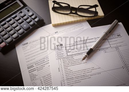 Us Individual Income Tax Return. Us Tax Forms On Desk