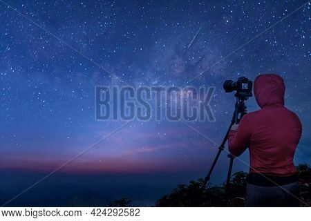 Photographer Taking Thailand Travel Milky Way Photography. Woman Photographer Shooting With Tripod A